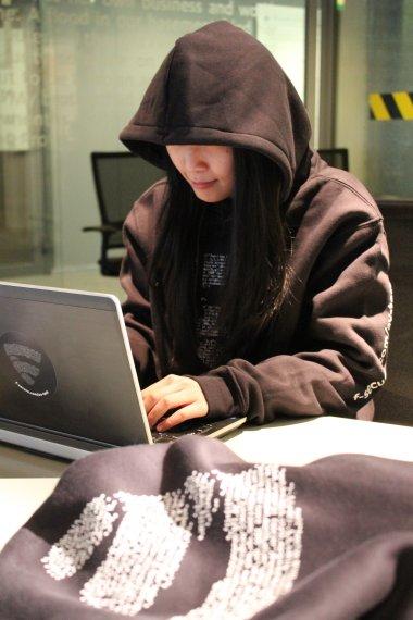 Karmina in a hoodie.